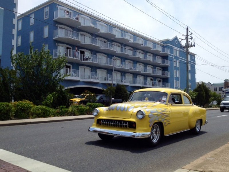 yellow car in front of large hotel in ocean city