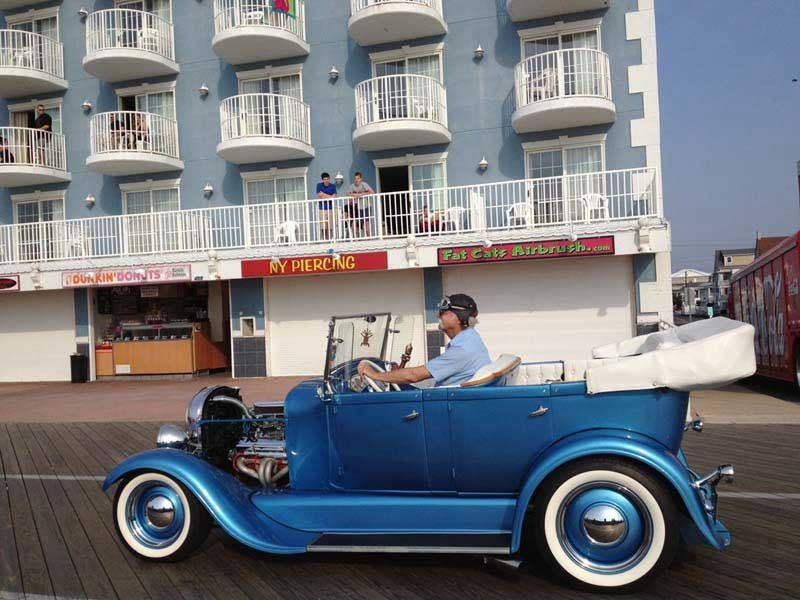 blue car in front of hotel in ocean city