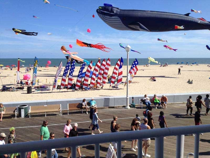 american flag and kites on beach