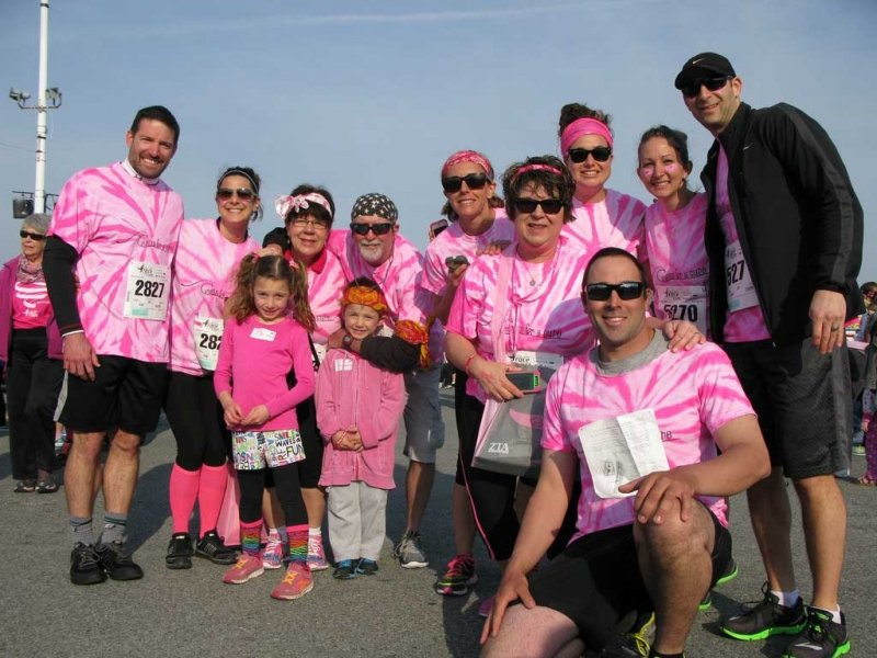 group of race runners in matching pink shirts